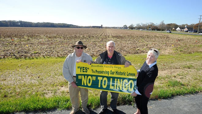 John Mateyko (left), Don Matzkin and Libby Owen, members of the Lewes Partnership for Managing Growth, stand at Kings Highway and Gills Neck Road near Lewes at the site of a proposed shopping center whose plans are being resubmitted for approval by the developer.