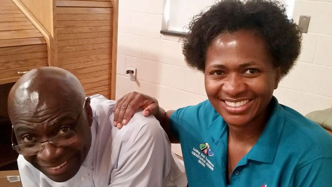 Co-founders Grace, right, and Dr. Seth Quartey of York take a quick break from packing medical supplies for the Building Solid Foundations trip to help people in Apam, Ghana.