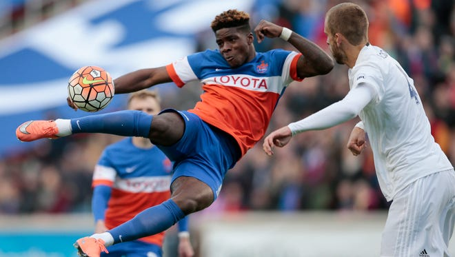 FC Cincinnati forward Sean Okoli (9), left, scores the first goal of the game on a scissor kick in the first half during the USL soccer game between the Charlotte Independence and FC Cincinnati, Saturday, April 9, 2016, at Nippert Stadium in Cincinnati. The goal marked the first-ever goal in FC Cincinnati at home during its inaugural season.