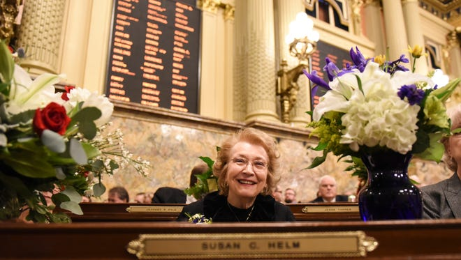 Rep. Sue Helm (104) sits at her desk in the house as members of the Pennsylvania House of Representatives were sworn in at the capitol on Tuesday, Jan. 3, 2017.