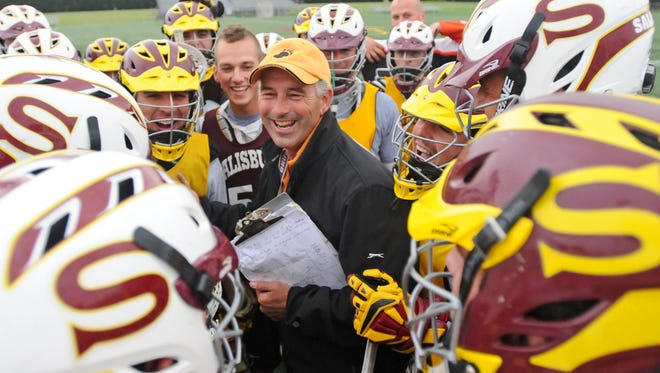Salisbury University men's lacrosse coach Jim Berkman laughs with his players following a practice on Friday at Seagull Stadium in preparation for Saturday's NCAA Division III men's lacrosse tournament.