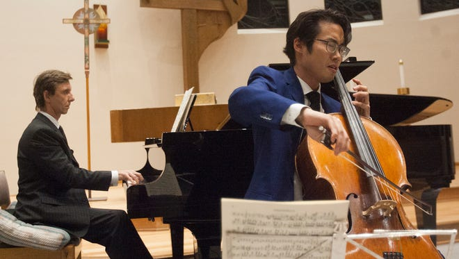 Pianist Wojciech Kocyan, left, accompanies cellist Yoshika Masuda on Chopin's Sonata in G Minor Op. 65 during a recent performance in the Samuelson Chapel on the California Lutheran University campus. Masuda is CLU's newly appointed assistant professor of music and director of string studies. He earned a doctorate in musical arts from the University of Southern California Thornton School of Music.