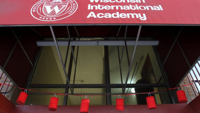Lanterns hang on an entrance to the Wisconsin International Academy.