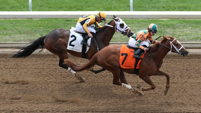 Gabriel Saez rode Hold Her Tight to edge out Adam Beschizza aboard Devine Mischief to win The Mill Ridge during opening day of the spring meet at Keeneland in Lexington.    Apr. 6, 2018