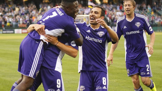 Louisville City FC's Kadeem Dacres (7) celebrates with Matt Fondy (9) and Juan Guzman (8) after scoring against Toronto FC during their May 16 game at Louisville Slugger Field.