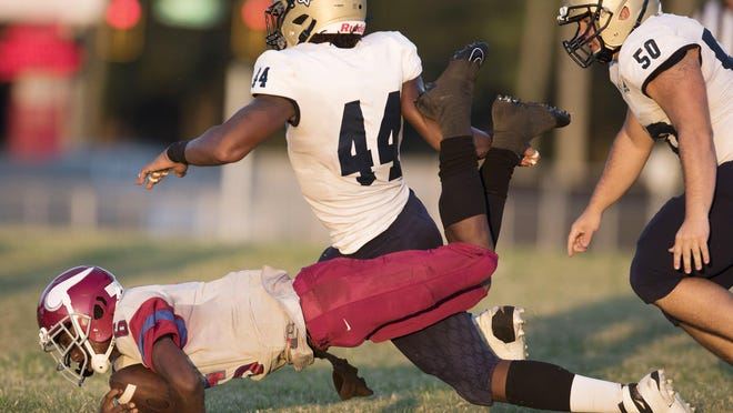 Sandalwood linebacker Branden Jennings (44) tackles a Raines player during an October game. Jennings, a top-five national recruit at the position for the 2021 class, announced his college commitment on Friday.