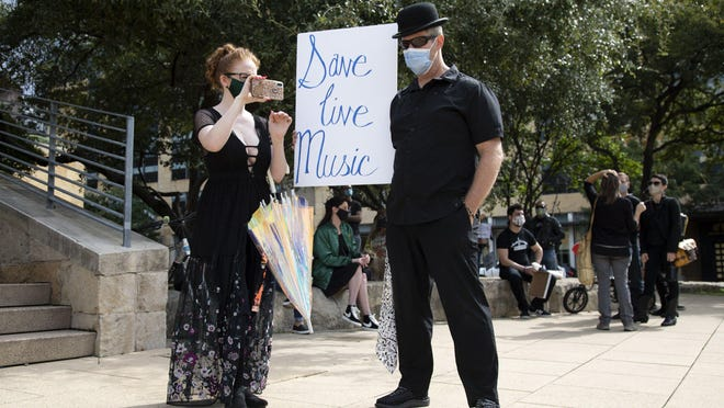 Local musicians Jeska Bailey and Guy Forsyth stand with a crowd of musicians, venue owners, artists and music fans who are  pushing for Austin City Council members to create a music venue preservation fund.