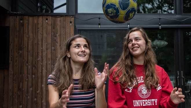 College up in the air? Isabel and Sophie Kochanek, both 18, play with a soccer ball at their home in La Grange, Illinois Aug. 3, 2020. Both sisters will be college freshmen in the fall. Sophie is enrolled at Carnegie Mellon, but she'll be taking classes online from home in the fall. Isabel is headed to Purdue Northwest in Hammond, where she plans to live in a dorm and play on the soccer team.