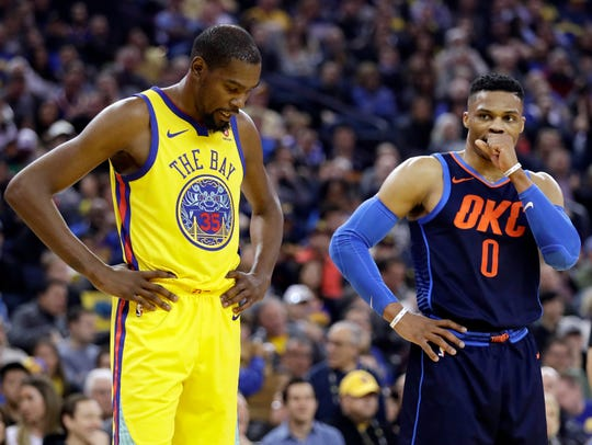Kevin Durant, left, stands next to Russell Westbrook