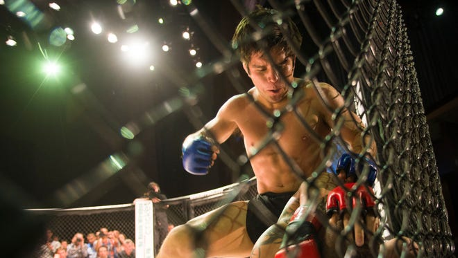 Henry Cejudo started his MMA career in March 2013 and won four straight in the first round. Here, he fights against Anthony Sessions during the bantamweight title match of local promotion World Fighting Federation MMA on Friday, April 19, 2013 at Wild Horse Pass Casino in Chandler.