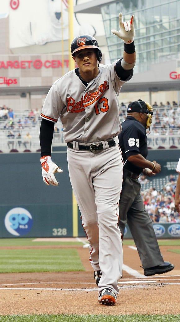 Baltimore Orioles' Manny Machado celebrates his solo