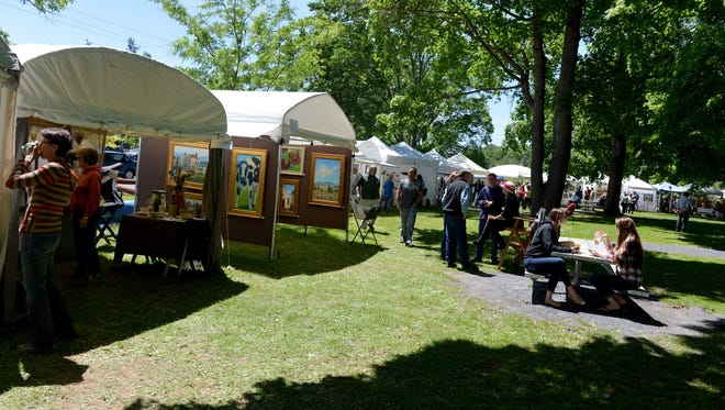 Participants browse the various vendor tents at Art in the Park at Gypsy Hill Park.
