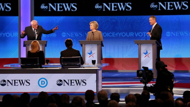 MANCHESTER, NH - DECEMBER 19: Democratic president candidates (L to R) Bernie Sanders, Hillary Clinton, and Martin O'Malley, debate at Saint  Anselm College December 19, 2015 in Manchester, New Hampshire. This is the third Democratic debate featuring Democratic candidates Hillary Clinton, Bernie Sanders and Martin O'Malley. (Photo by Andrew Burton/Getty Images)