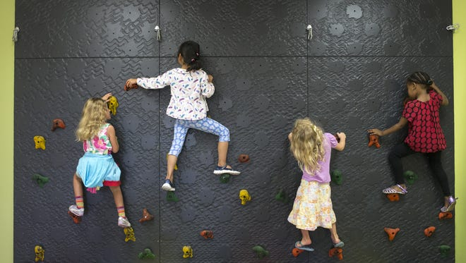 Pre-kindergarten students climb at Bright Horizons Family Center at ASU Research Park in Tempe on July 21, 2016. Mesa's Early Childhood Education Task Force unveiled its recommendations at a recent City Council study session and received mixed results.