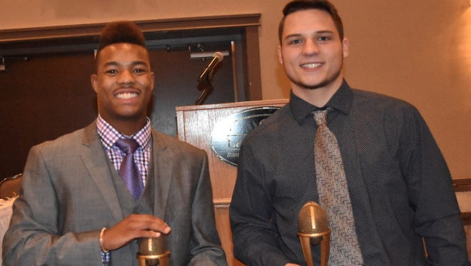 Thrilled to share co-MVP honors are Canton football players Julian Thornton (left) and Jake Warner. They were honored Nov. 21 at Laurel Manor in Livonia.
