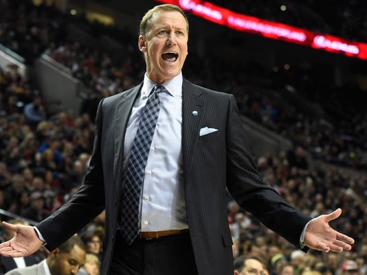 Portland Trail Blazers head coach Terry Stotts reacts to an officials call during the second half of an NBA basketball game against the New Orleans Pelicans in Portland, Ore., Monday, Dec. 14, 2015. The Trail Blazers won 105-101. (AP Photo/Steve Dykes)