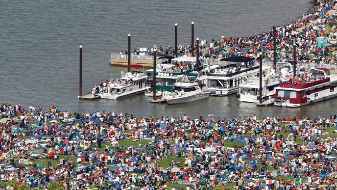 2010 file photo: Crowds gather at Waterfront Park to watch the Thunder Over Louisville air and fireworks show.