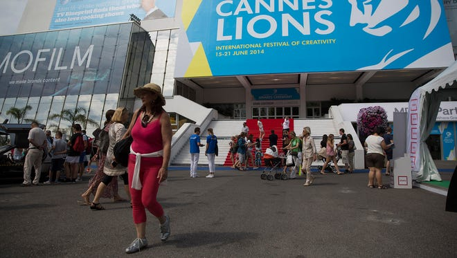 Pedestrians pass outside the Cannes Congress Center during the Cannes Lions International Festival of Creativity in Cannes, France, on June 17.