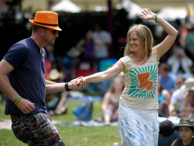 David Goodwyn and his wife Jessica dance during a performance