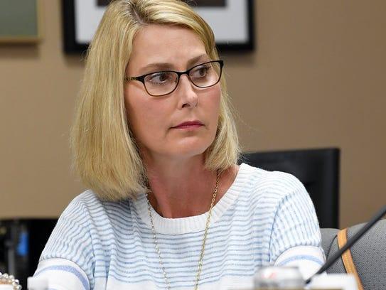 Montgomery School Board member Melissa Snowden looks