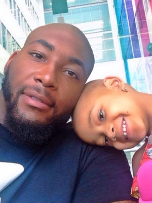 Devon Still and his daughter, Leah, posed for a photo while she was undergoing cancer treatment.