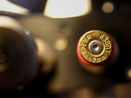Bullets and casings examined in a comparison microscope