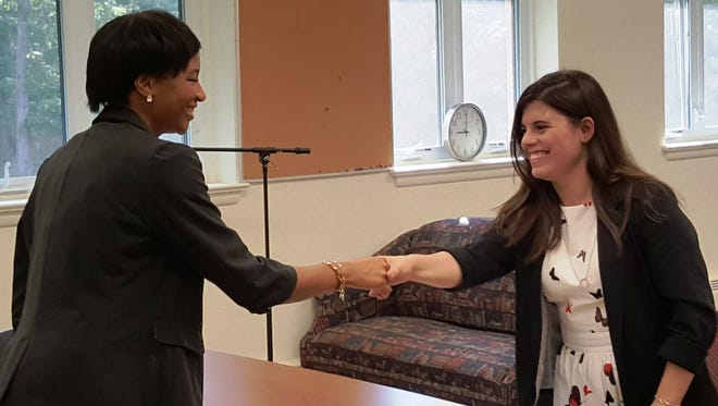 Brittany Himes (left) of National Freight Industries greets Olivia Marrone, a senior at Our Lady of Mercy Academy, at the start of a mock interview. Seniors participated in the interviews with professional recruiters to help prepare for future interviews with colleges and prospective employers.
