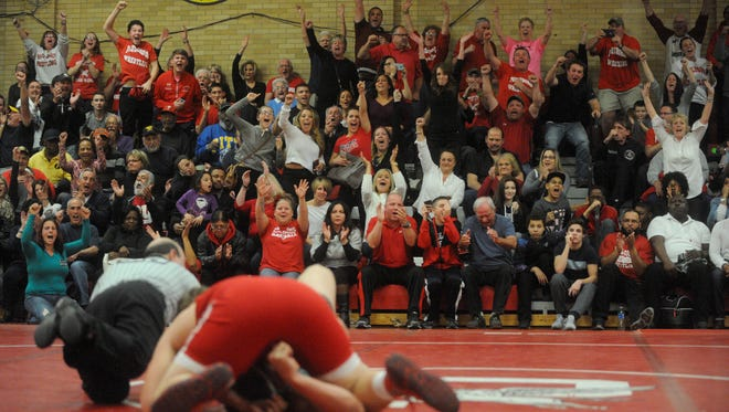 Paulsboro fans celebrate as Frank Mooney pins Clearview's Jackson Love in the 285-pound bout in the Pioneers' win on Jan. 30. Atmosphere's like the one at the Red Raiders' home gym are few and far between now with more teams filling Saturdays with quad meets.