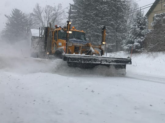 A snow plow cleans Route 366 in the hamlet of Etna,