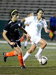 Abilene High's Bertha Sanchez races a Haltom City Haltom player to the ball during the Lady Eagles 1-0 win Friday at Shotwell Stadium.