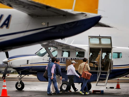 Travelers board a Southern Airways Express flight to Atlanta on March 8, 2016.