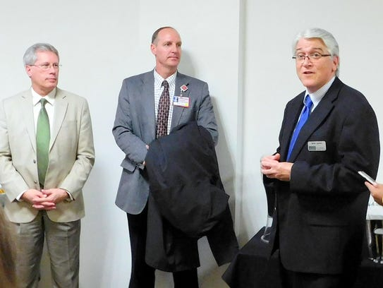 Dr. D. Ryan Carstens, President of Eastern New Mexico University-Ruidoso, at left, is welcomed at a reception in his honor Monday by Brad Treptow, center, College Board chairman, and Dr. Jamie Laurenz, vice president for Academic Affairs, ENMU Portales. Dr. Clayton Alred, who retired as the president, will be honored at a reception from 6 p.m. to 8 p.m., Jan. 30, at the Elegante Lodge and Resort in Ruidoso.