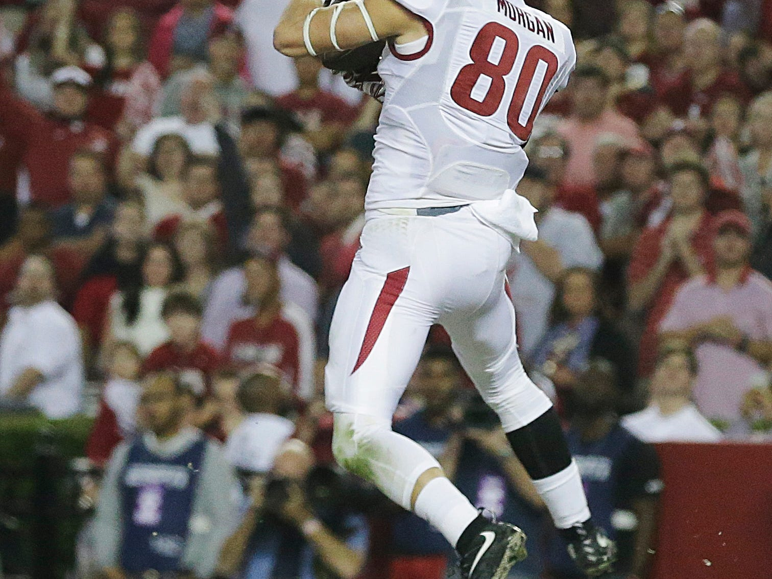 Arkansas wide receiver Drew Morgan (80) catches the ball in the end zone and scores against Alabama in the first half of an NCAA college football game, Saturday, Oct. 10, 2015, in Tuscaloosa, Ala. (AP Photo/Brynn Anderson)