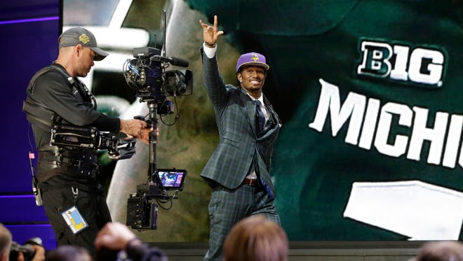 """The Vikings took former Michigan State cornerback Trae Waynes with the 11th pick in the first round. """"It was a moment we wanted to be able to stand back and say: 'Wow, here we are,'"""" coach Mark Dantonio said of watching Waynes get drafted in Chicago."""