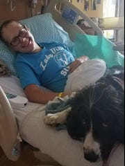 Jordyn, a huge dog lover, pets a friendly face. She was visited by therapy dogs during her two months at Children's Hospital of Wisconsin.