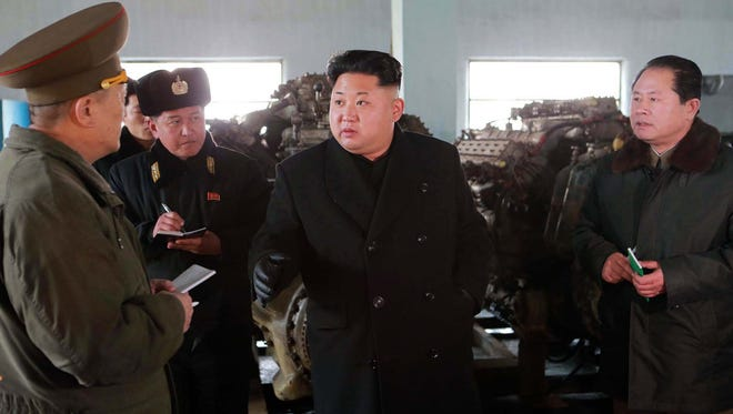 Russian Foreign Minister Sergei Lavrov told reporters on Jan. 21 that Kim Jong Un, center, could attend a ceremony marking the 70th anniversary of the end of World War II.