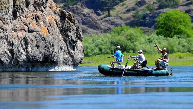 Anglers fly fish the Missouri River below Craig.