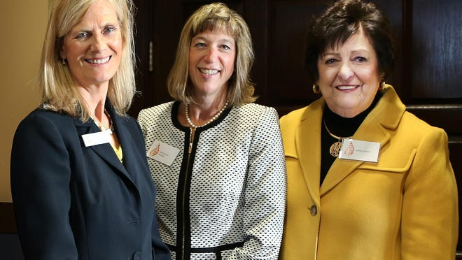 Lisa Louis, left, executive director of the Catholic Foundation of Northwest Pennsylvania, is shown at an October 2019 donor appreciation event with board members Karen Burton-Horstman, center, and Marlene Mosco. The foundation is now celebrating receipt of its largest gift ever from an individual.