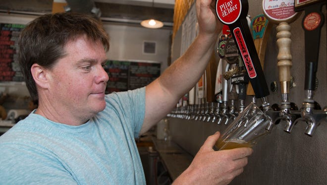 Choice City Butcher & Deli owner Russ Robinson pours Pliny the Elder  Sept. 1 at the Old Town Fort Collins bar. Russian River Brewing Co.'s popular double IPA is a hard-to-find treat in Fort Collins' beer scene.