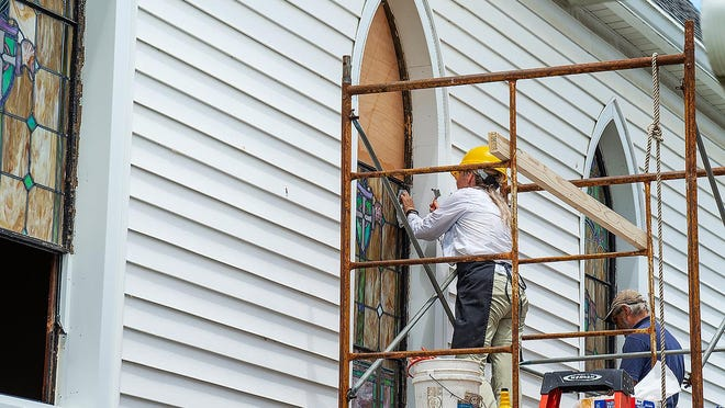Workers from Pike Stained Glass Studio in Rochester were doing up-close, detailed work Thursday on windows at Emanuel Lutheran Church on West William Street in Corning.