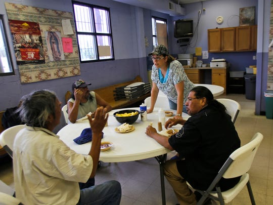 Volunteer Amy Pritchard with the First Baptist Church in Bloomfield takes orders from clients Sept. 2 during dinner at Catholic Charities in Farmington.