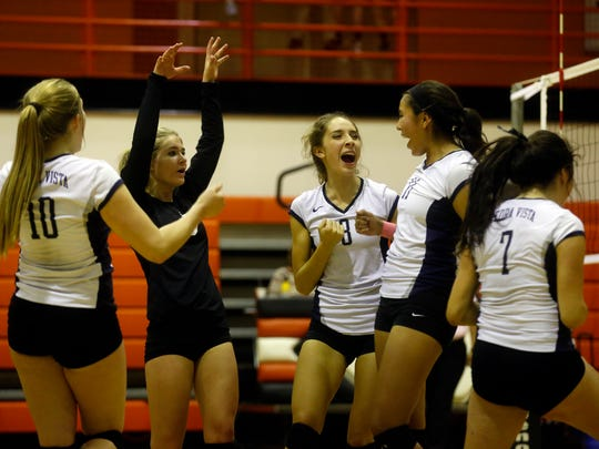 Piedra Vista players celebrate after defeating Aztec on Thursday at Lillywhite Gym in Aztec.