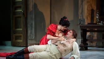 Tosca (Evelina Dobračeva) comforts Cavaradossi (Marcello Giordani) in Cincinnati Opera's new production of Giacomo Puccini's Tosca.