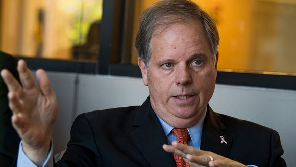 U.S. Senate candidate Doug Jones talks with the Montgomery