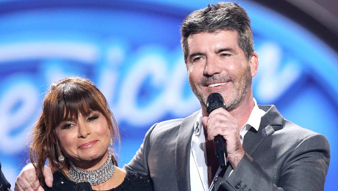 Paula Abdul and Simon Cowell are used to doing live competition shows together.