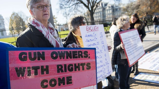 Demonstrators with the group We the People for Sensible Gun Laws rally for gun safety legislation in Washington, D.C., on Dec. 7, 2015. AFP PHOTO / SAUL LOEB SAUL LOEB/AFP/Getty Images ORG XMIT: - ORIG FILE ID: 547076689