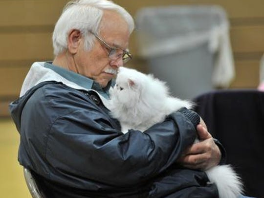 Royd Honeycutt, 63, takes a rest with his cat Penelope at the Central Wisconsin Cat Club's 2014 cat show.