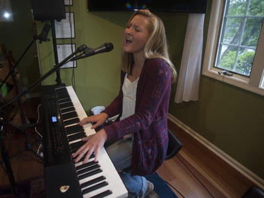 CC Miles of Medford Lakes plays the electric keyboard and sings at her home studio. The Shawnee High School freshman has an album under her belt and another in the works.