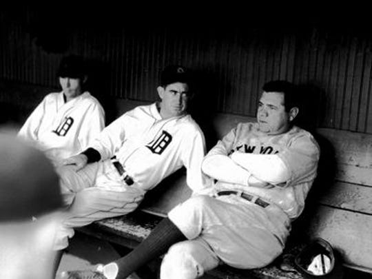 Babe Ruth chats with Mickey Cochrane in the Navin Field dugout in this undated photograph.