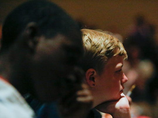 Derrick Melton, right, listens to Mayor Hogsett's speech at Chapel Hill 7th and 8th Grade Center on Tuesday, May 29, 2018.
